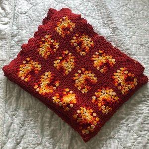 Crocheted throw blanket red orange yellow